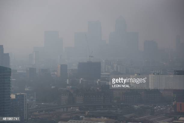 Air pollution hangs in the air lowering visibility in London on April 2 2014 Saharan dust mixed with pollution from Europe and the UK has blanketed a...