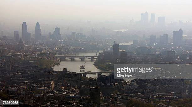 Air pollution hangs over the heart of London in this view along the River Thames towards the city on April 20 2007 in London England