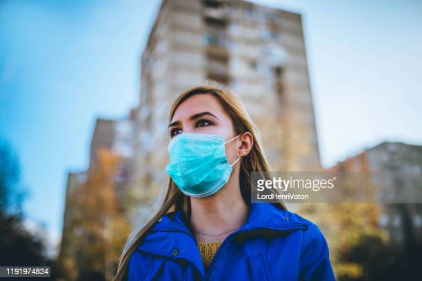 air pollution or virus epidemic in the city - mascherina chirurgica foto e immagini stock