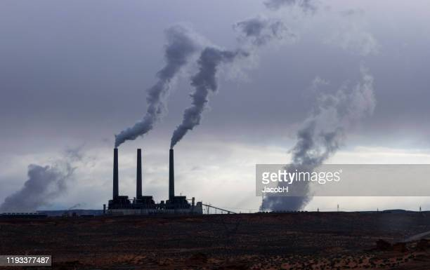 air pollution - chimney stock pictures, royalty-free photos & images