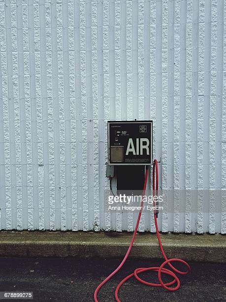 air pump on wall at fuel pump - air pump stock photos and pictures