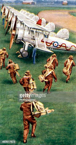 Air Raid Precautions cigarette card British 1938 Pilots practicing scrambling their interceptor fighters One of a set of 50 cards issued by WD HO...