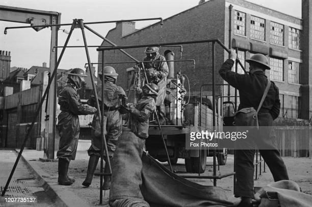 Air Raid Precautions going through a gas contamination drill in Finsbury Park London England circa 1940
