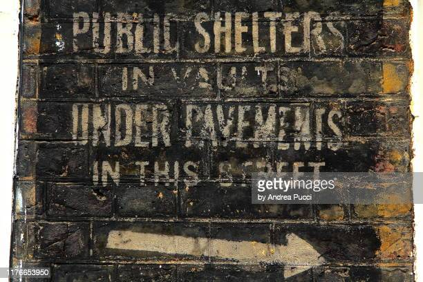 air raid shelter sign, westminster, london, united kingdom - world war ii stock pictures, royalty-free photos & images