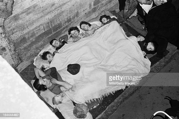 Air Raid Shelter Under The Railway Arches South East London England Nine members of the elevenstrong O'Rourke family of St James's Road Bermondsey...