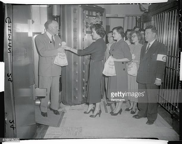 Air Raid Test Public National Bank 161st St and Gerard Ave Bank manger Edward Froede receives money from tellers and cashiers to be locked in vault