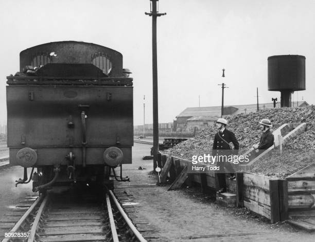 Air raid wardens leaving a shelter in a goods yard on the London and North Eastern Railway 1st December 1939