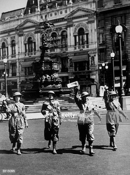 Air raid wardens sound a warning at Piccadilly Circus