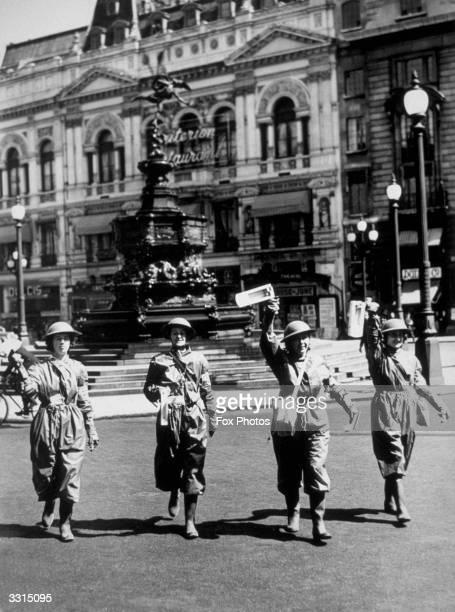 Air raid wardens sound a warning at Piccadilly Circus
