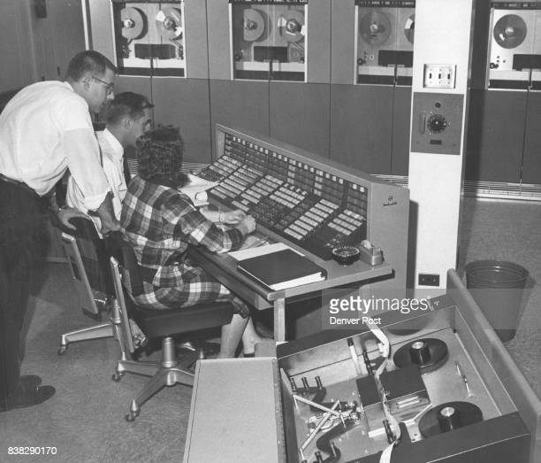 Air Reserve Record Center New Computer Ready For Work Alan Schlegel of the Radio Corporation of America watches as programmer John Reisbig and Mrs...