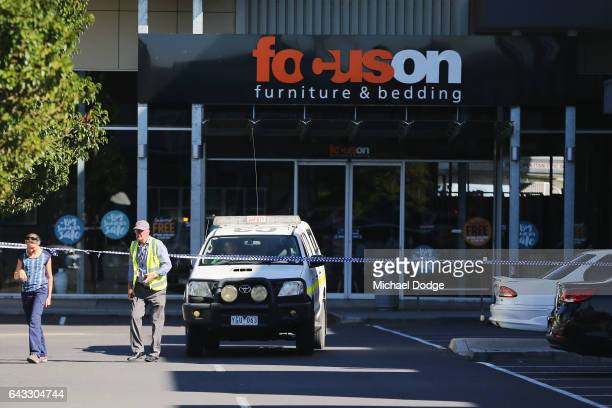 Air Safety Investigators at the DFO Melbourne Shopping Centre work at the scene of a charter plane crash on February 21 2017 in Melbourne Australia...