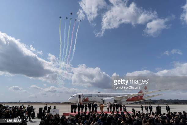 Air SelfDefense Force's Blue Impulse aerobatic team fly during the Tokyo 2020 Olympic Games Flame Arrival Ceremony at the Japan Air SelfDefense Force...