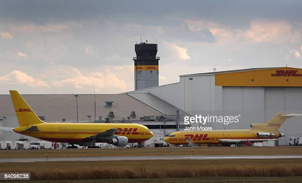 Air shipment planes wait loading at the DHL hub December 19 2008 in Wilmington Ohio Massive job cuts between air shipping partners DHL and ABX the...