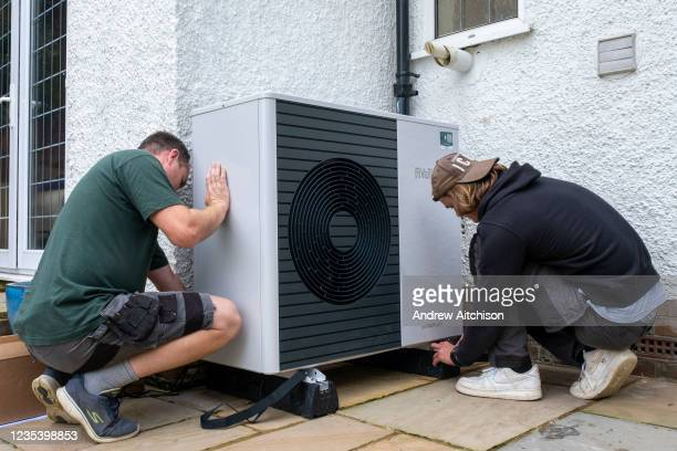 Air source heat pump installers from Solaris Energy installing a Vaillant Arotherm plus 7kw air source heat pump unit into a 1930s built house in...