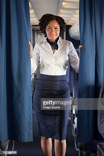 Air stewardess with curtain