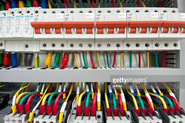 air switches and cables neatly arranged in the electrical control cabinet - electrical panel box stock pictures, royalty-free photos & images