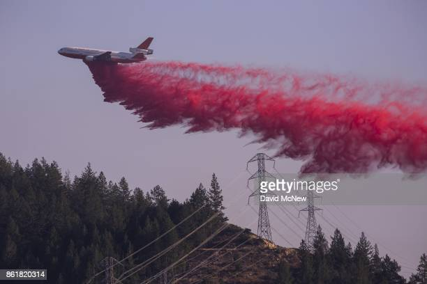 Air tanker drops fire retardant at the Oakmont Fire on October 15, 2017 near Santa Rosa, California. At least 40 people were killed with many are...