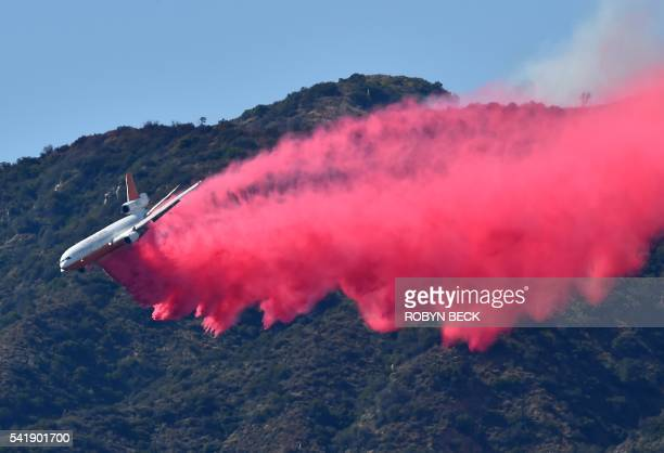 DC10 air tanker drops fire retardant June 20 2016 in Duarte California Twin fires have already scorched more than 3500 acres and forced evacuations...