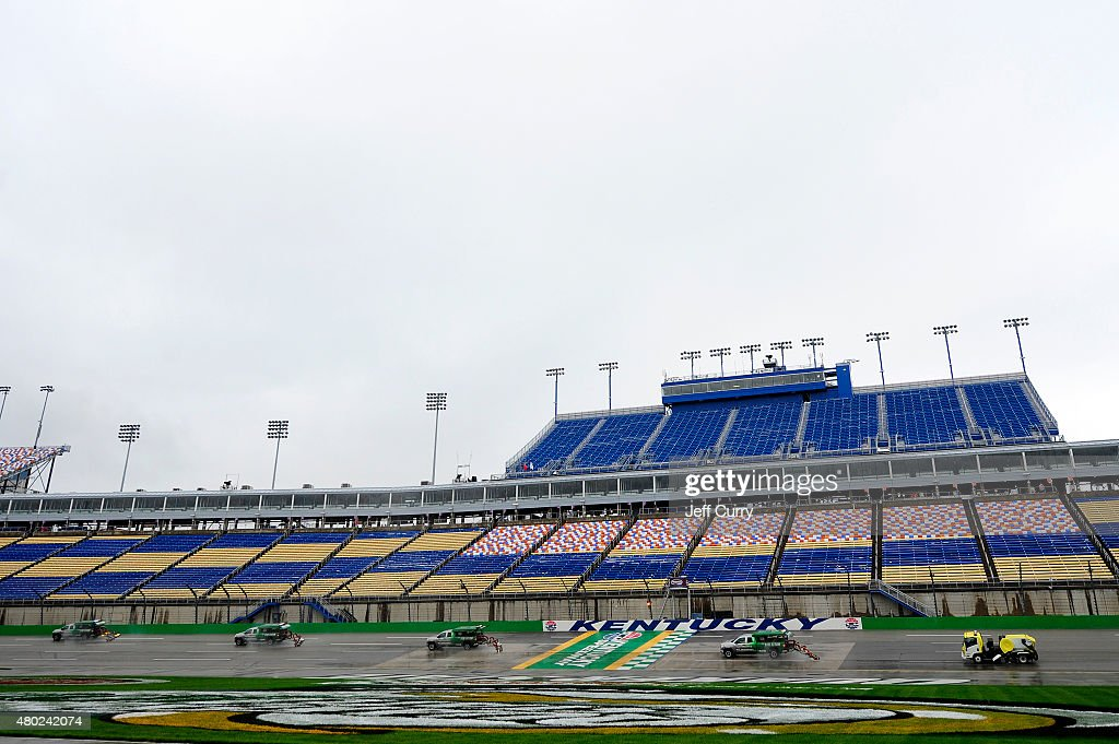 Air Titan 2.0 trucks work to dry the track during a rain delay in practice for the NASCAR Sprint Cup Series Quaker State 400 Presented by Advance Auto Parts at Kentucky Speedway on July 10, 2015 in Sparta, Kentucky.