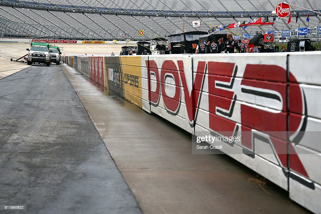 Air Titan 2.0 trucks work to dry the track prior to the NASCAR XFINITY Series Drive Sober 200 at Dover International Speedway on October 2, 2016 in Dover, Delaware.