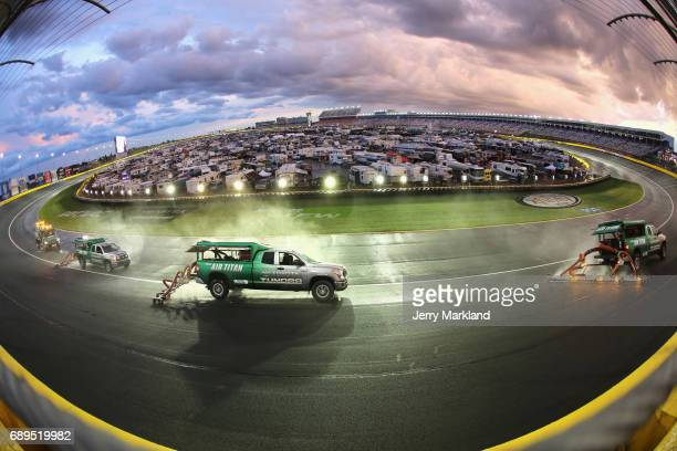 Air Titans dry the track during a rain delay during the Monster Energy NASCAR Cup Series CocaCola 600 at Charlotte Motor Speedway on May 28 2017 in...
