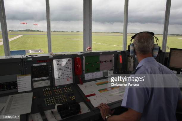 Air traffic control staff at RAF Scampton watch from the control tower as the Red Arrows team leave for a display on June 22 2012 in Scampton England...