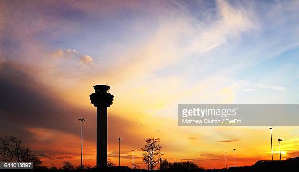 Air Traffic Control Tower Against Cloudy Sky During Sunset