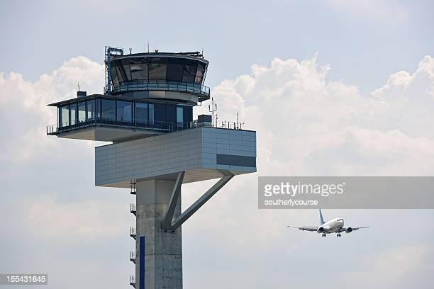 air traffic control tower and approaching aircraft - control tower stock pictures, royalty-free photos & images
