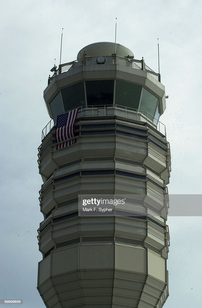 Air traffic control tower at Regan National Airport, draped with American flag.