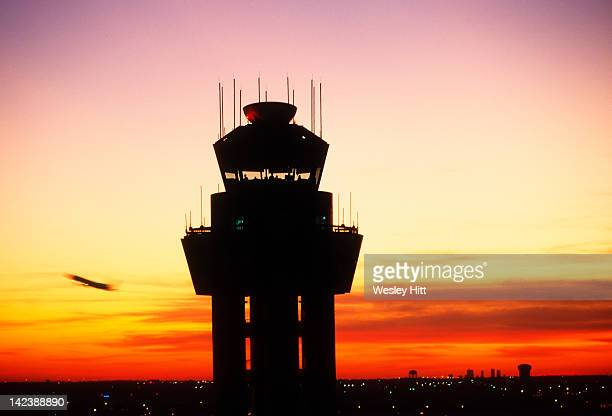 Air traffic control tower at sunset