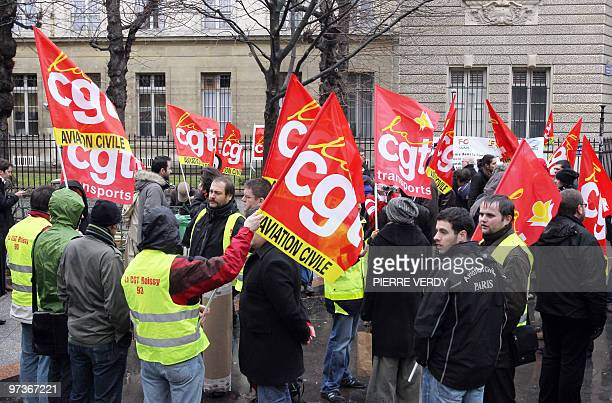 Air traffic control union members gather near the French Transport ministry on February 26 in Paris as an air traffic controllers' strike goes into...