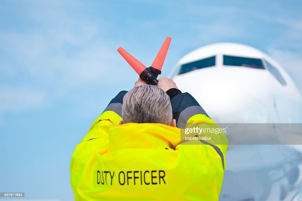 Air traffic controler holding signals : Stock Photo