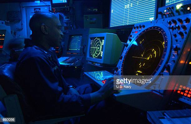 Air Traffic Controller 2nd Class Odarious Chambers from Andalusia AL mans the approach radar watch January 6 2002 aboard the USS Theodore Roosevelt...