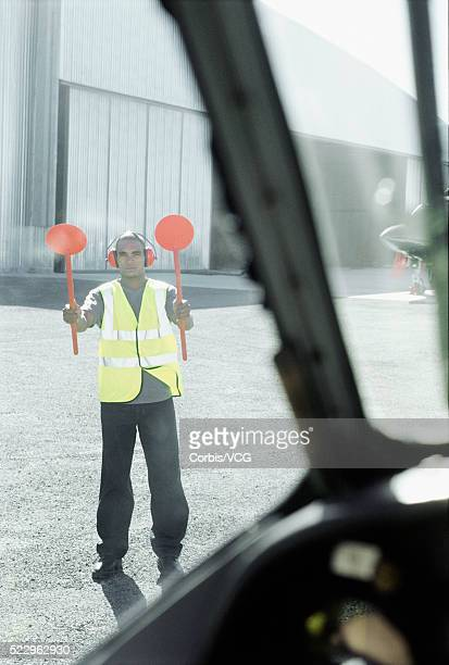 Air Traffic Controller Directing Plane