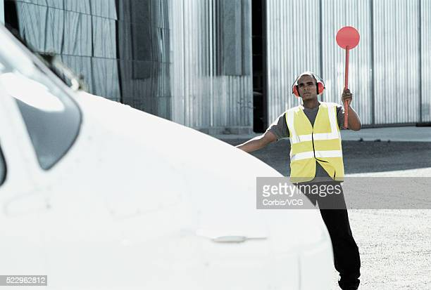 Air Traffic Controller Directing Small Plane