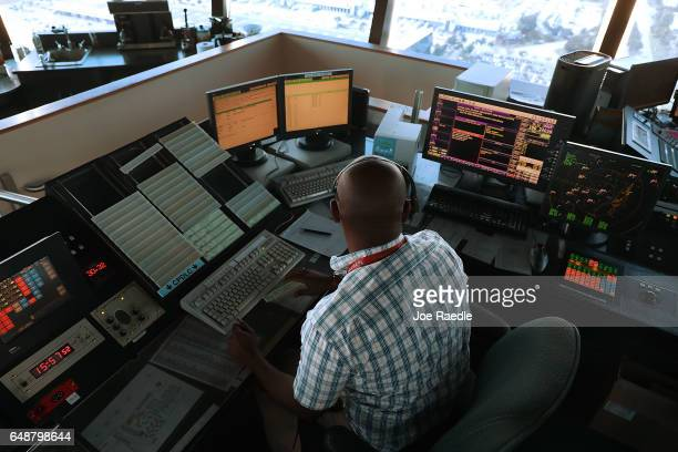 Air traffic controller Emil Watson uses Data Comm part of the FAA's Next Generation Air Transportation system in the control tower at Miami...