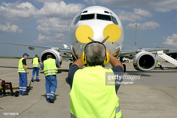 Air traffic controller in front of the airplane of the Ryanair at the airport FrankfurtHahn
