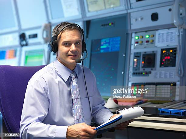 Air traffic controller in radar room