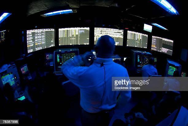 Air Traffic Controller monitors skies and sea.