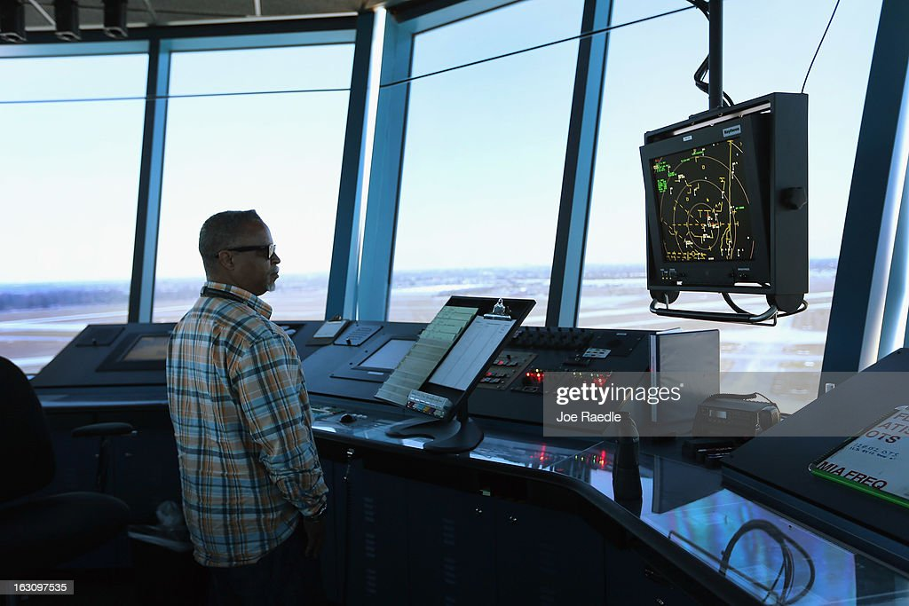 Air Traffic Controller, Robert Moreland, works in the control tower at Opa-locka airport on March 4, 2013 in Opa-locka, Florida. Due to sequestration cuts, small airports such as Opa-locka, which is a popular spot for corporate jets to land, will close its control tower in April to save federal transportation dollars under the federal spending cuts that went in to affect last week. Even though the control tower will close, planes will still be able to use the airport just without the help from the control tower.