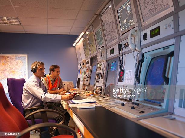 Air traffic controllers in radar room