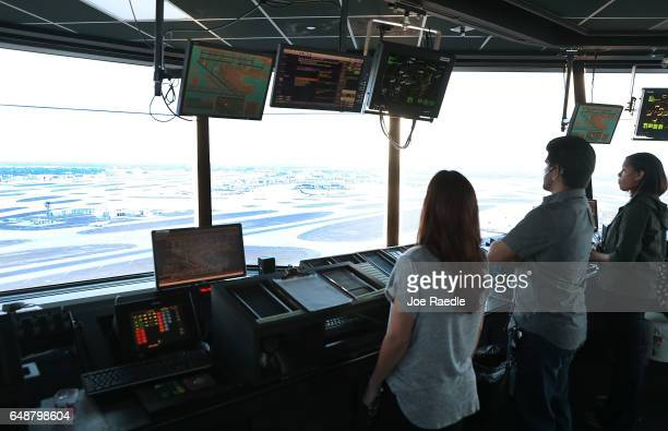 Air traffic controllers keep watch using Data Comm part of the FAA's Next Generation Air Transportation system in the control tower at Miami...