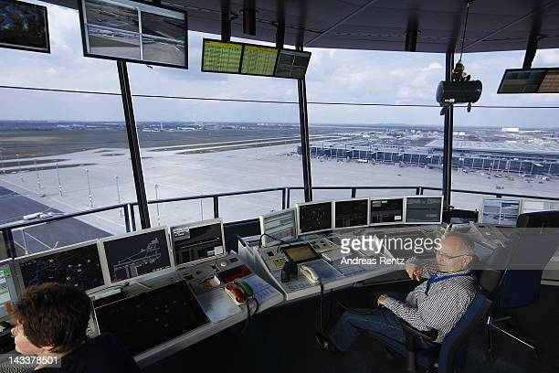 Air traffic controllers look out onto the tarmac following the official inauguration of the new control tower at Willy Brandt Berlin Brandenburg...