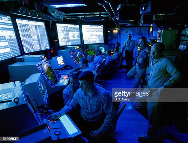 Air Traffic Controllers Man The Radar Screens Of The Increasingly Busy Air Operations Center Aboard The USS Theodore Roosevelt As Nato Steadily...