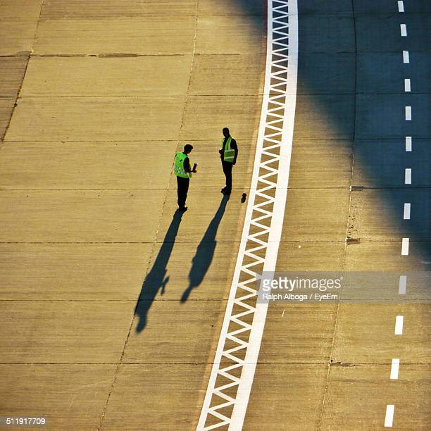 Air traffic controllers standing on runway