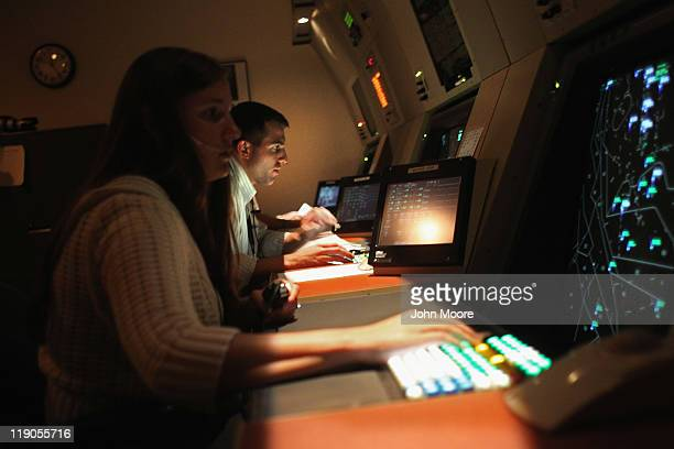 Air traffic controllers train on a flight simulator on July 14 2011 at the Denver International Airport in Denver Colorado The Federal Aviation...