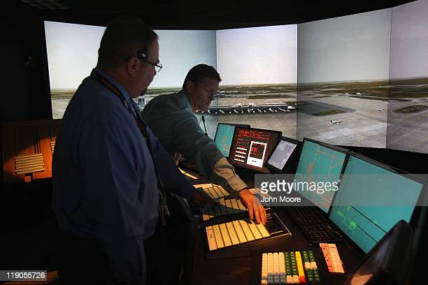 Air traffic controllers work inside a tower simulator on July 14 2011 at the Denver International Airport in Denver Colorado The Federal Aviation...