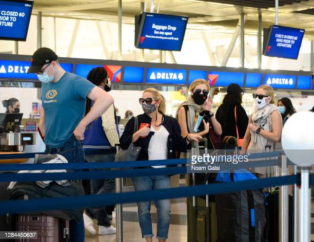 Air travelers check in for their flights in John F. Kennedy International Airport on November 07, 2020 in New York City. The global pandemic has had...
