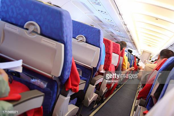 Air Travelers in Airplane Cabin
