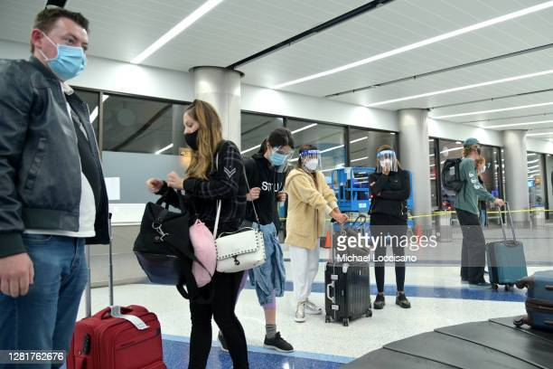 Air travelers wait for their checked baggage at Los Angeles International Airport on October 22 2020 in Los Angeles California The global pandemic...